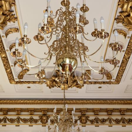 An ornate ceiling and chandelier detail