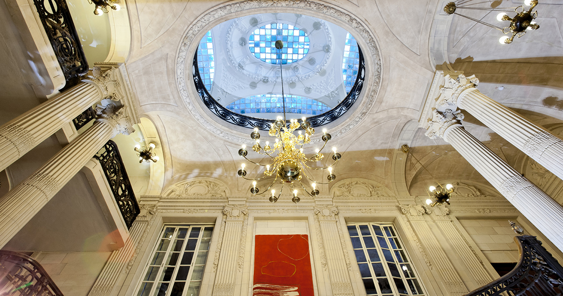 The domed ceiling and chandelier at historic venue 10-11 Carlton House Terrace.