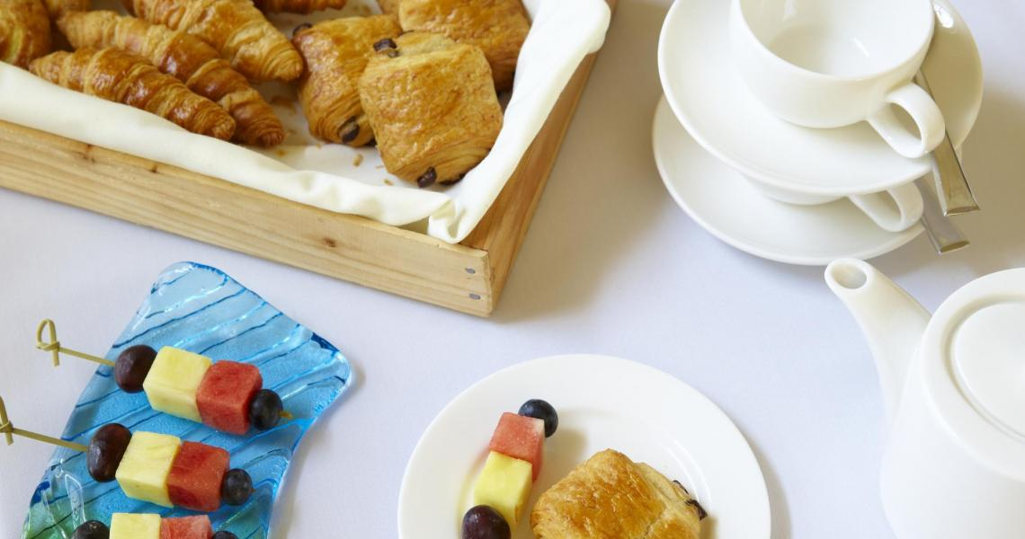 Large croissants and fruit skewers