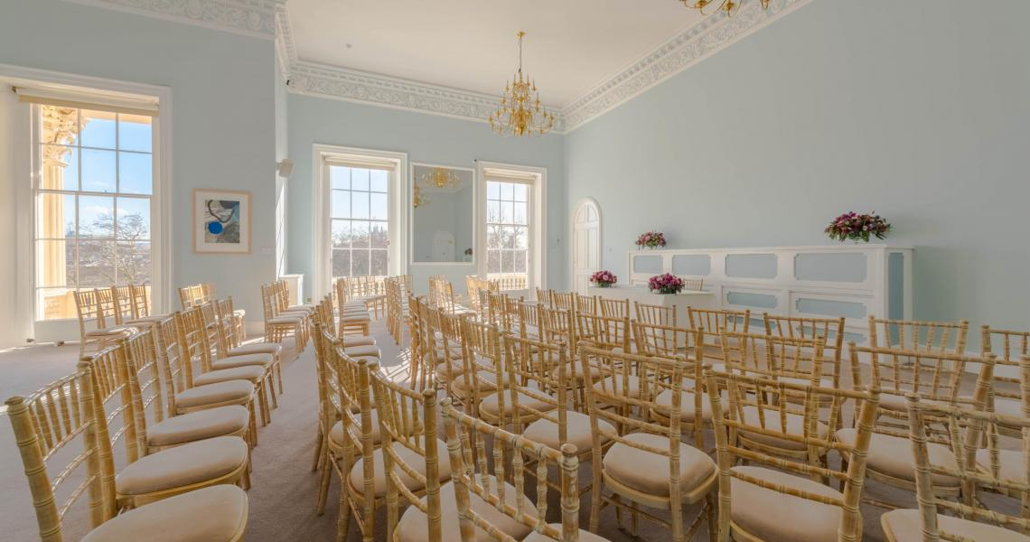 A wedding ceremony set in the Wolfson Room
