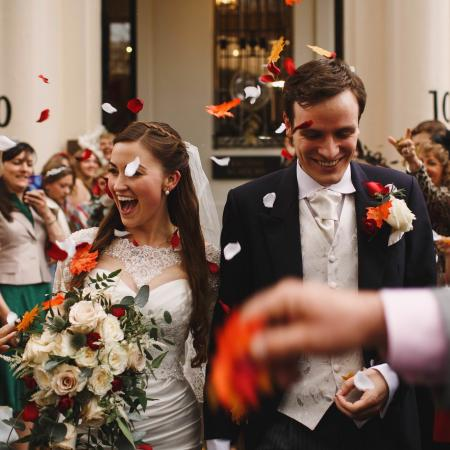 Newlywed couple leaving No. 10 with confetti