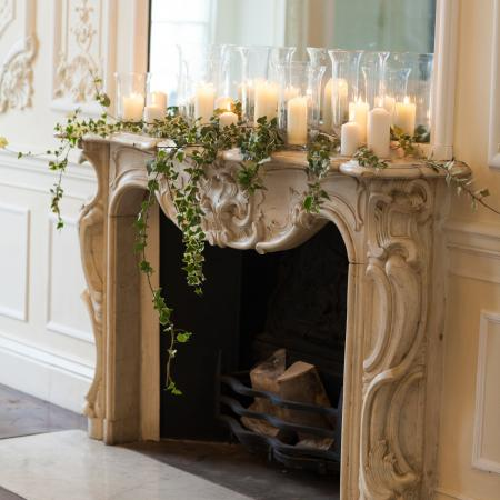 Floristry on the Music Room fireplace by All for Love London