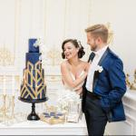 Wedding couple with a geometric wedding cake  thumbnail