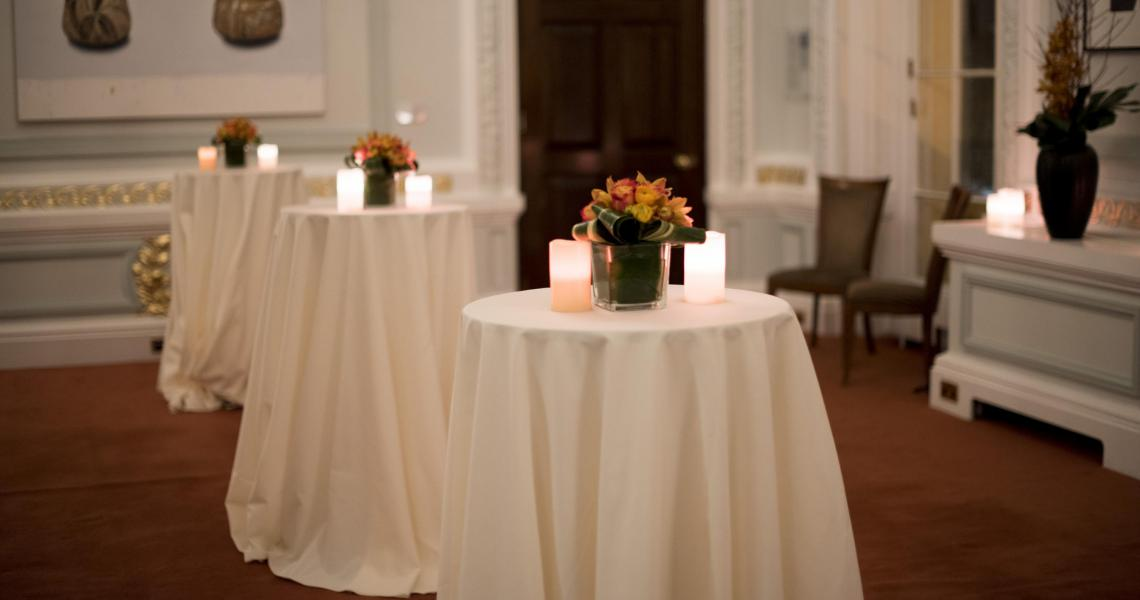 Tall tables with flowers and candles for a reception